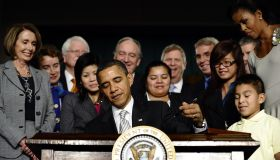 US President Barack Obama signs into law