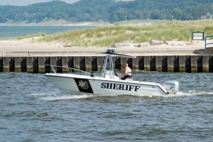 Sheriff boat patroling the waters of Lake Michigan at Manistee, Michigan