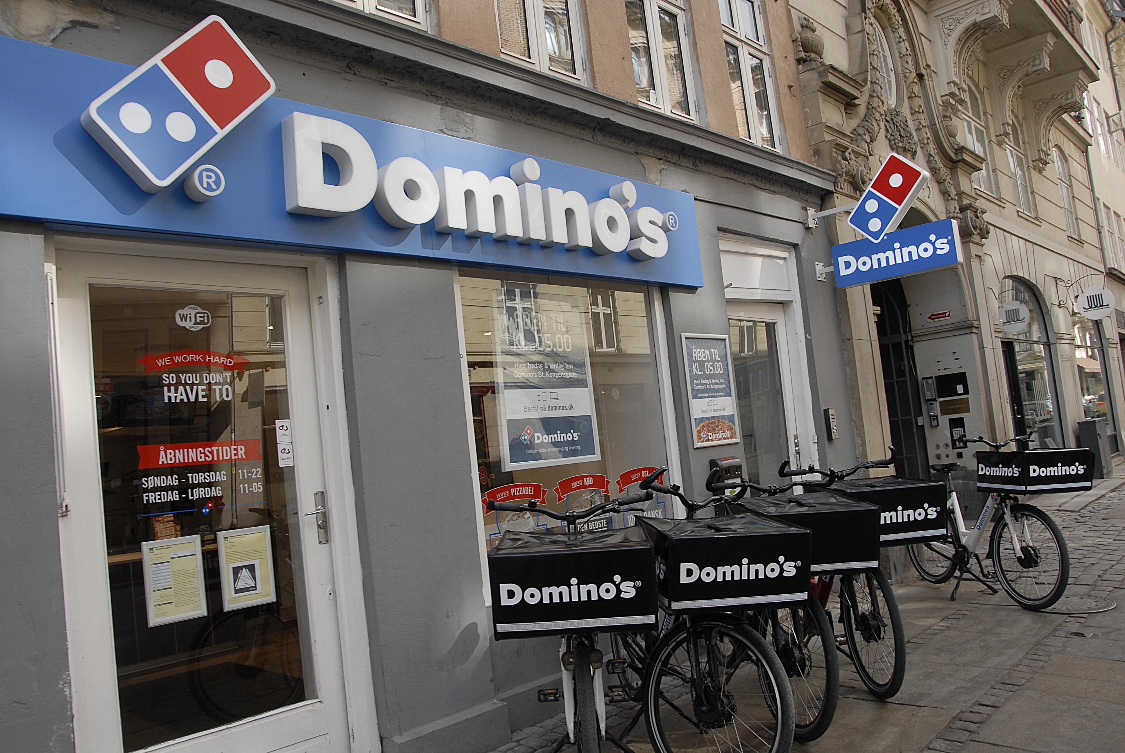 Dominos pizza delivery by bikes in Copenhagen, Denmark