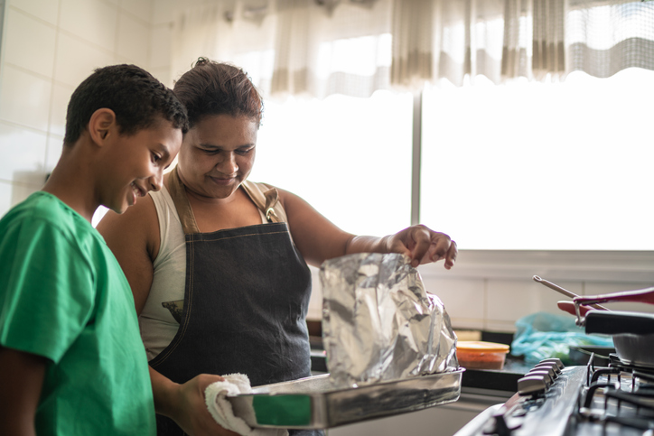 Afro latinx mother and son cooking at home