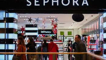 People are seen walking past the Sephora shop...