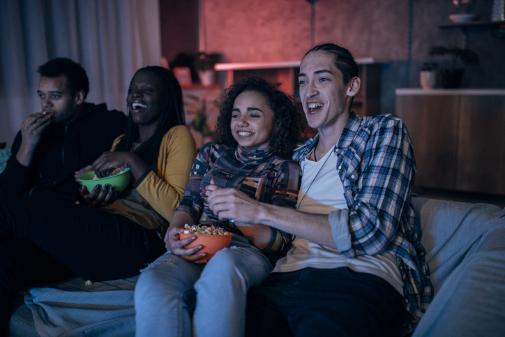 Multi-ethnic friends watching TV