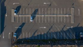 Aerial -Few cars parking in a parking lot.