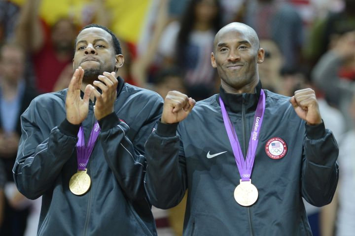 US Kobe Bryant (R) poses with his gold m